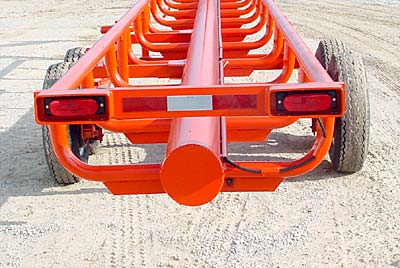 GoBob Pipe and Steel - Orange Ox - The tail lights are protected by heavy box tubing and the wiring is protected by schedule 40 pipe. This picture also shows the one piece els (no welds to break), reinforced by ¼
